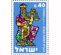 Abb. 1 Salomo wird durch eine Waage als gerechter Richter und durch einen Bauplan als Erbauer des Tempels dargestellt (Briefmarke aus Israel, 1960).